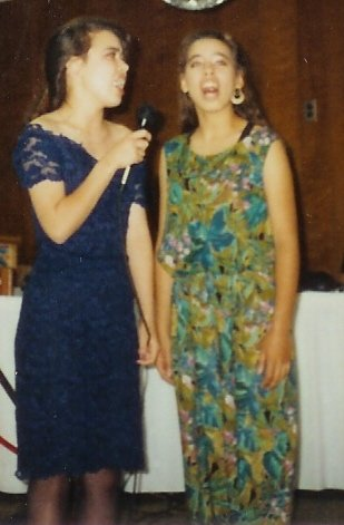 Me (in the navy blue) and my sister singing together