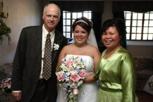 Me with Mom & Step-dad on my wedding day